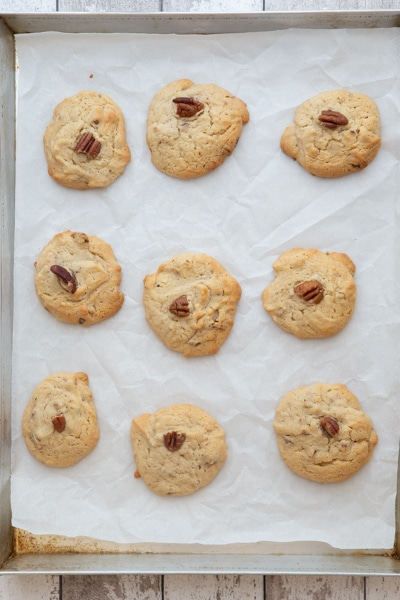 Baked maple cookies on a cookie sheet.